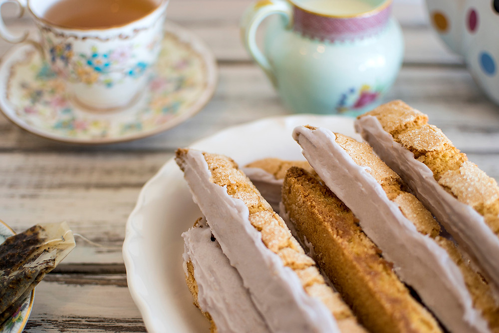 Honey Lavender Lemon Biscotti served in plate with a cup of tea