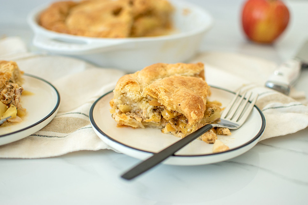 Recipe for Cheddar Apple Chicken Pot Pie is the best healthy version of chicken pot pie! This easy savory pie recipe will keep you warm and cozy all winter long. Made with a chicken broth filling instead of cream filling, this savory pie is healthier than most recipes! #potpie #organic #organicpie #chickenpotpie #cheddarapple #savorypie #chickenpie