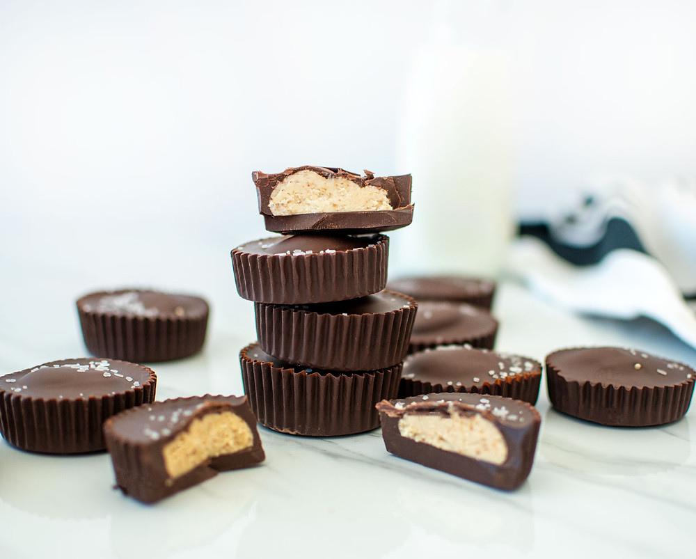 Super easy and delicious Sea Salt Almond Butter Cups, this recipe is so simple your whole family will love it! Great recipe for snacks and on the go, it's also naturally gluten free! #almondbutter #darkchocolate #seasaltdarkchocolate #easycandyrecipe #candyrecipe