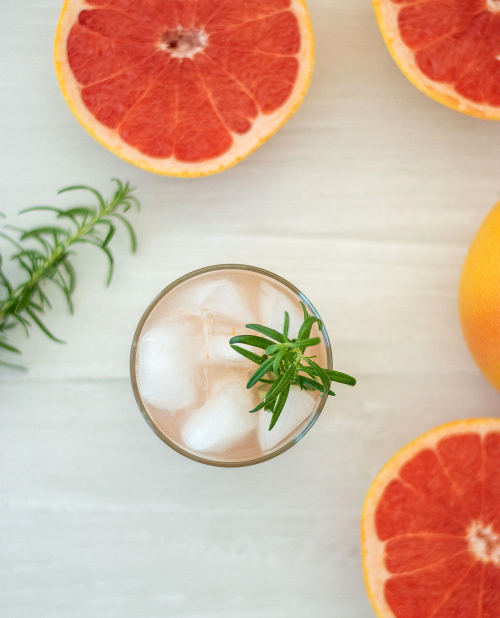 Easy and delicious Rosemary Greyhound Cocktail recipe. Three ingredient recipe for a delicious citrus cocktail using fresh grapefruits #cocktail #rosemarycocktail #greyhoundcocktail #citrusseason #inseason #pinkdrink