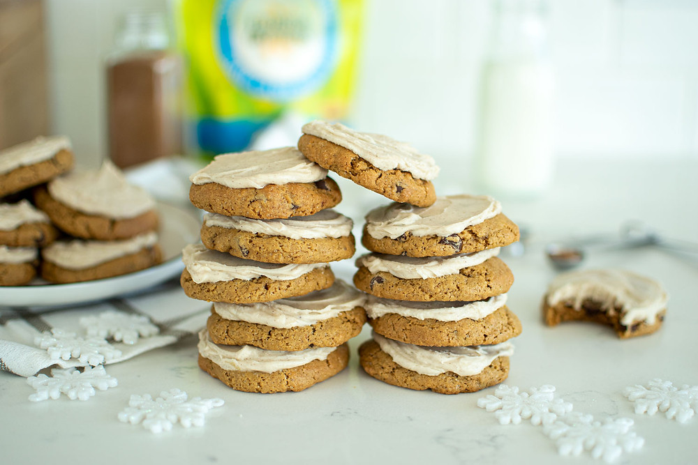 Homemade soft and chewy chocolate chip cookie recipe with a Chinese five spice frosting that is the best recipe for Christmas cookies! This easy classic chocolate chip cookie recipe has a sweet frosting on top made with Chinese five spice for a nontraditional Christmas cookie that you'll love #organiccookies #chinesefivespice #chocolatechipcookies #christmascookies #holidaycookies
