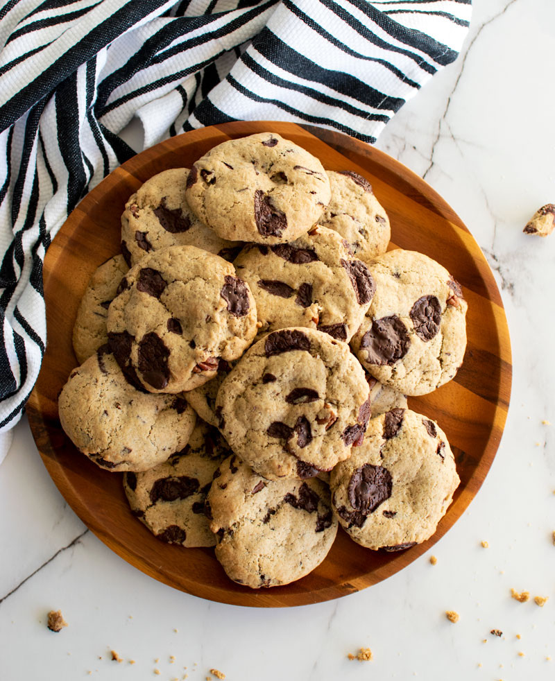Easy chewy from scratch cardamom chocolate chip cookie recipe, healthy chocolate chip cookies, chewy chocolate chip cookies, vegan chocolate chip cookies, gluten free chocolate chip cookies, cardamom cookies, high altitude baking, christmas cookies #cookies #organic #organiccookies #milkandcookies #chocolatechipcookies #chocolatechip #vegan #vegancookies #darkchocolate