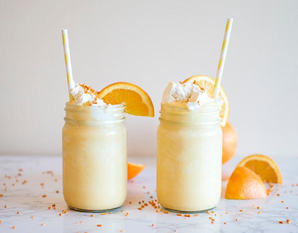 Orange Cream Milkshakes in a jar with straws