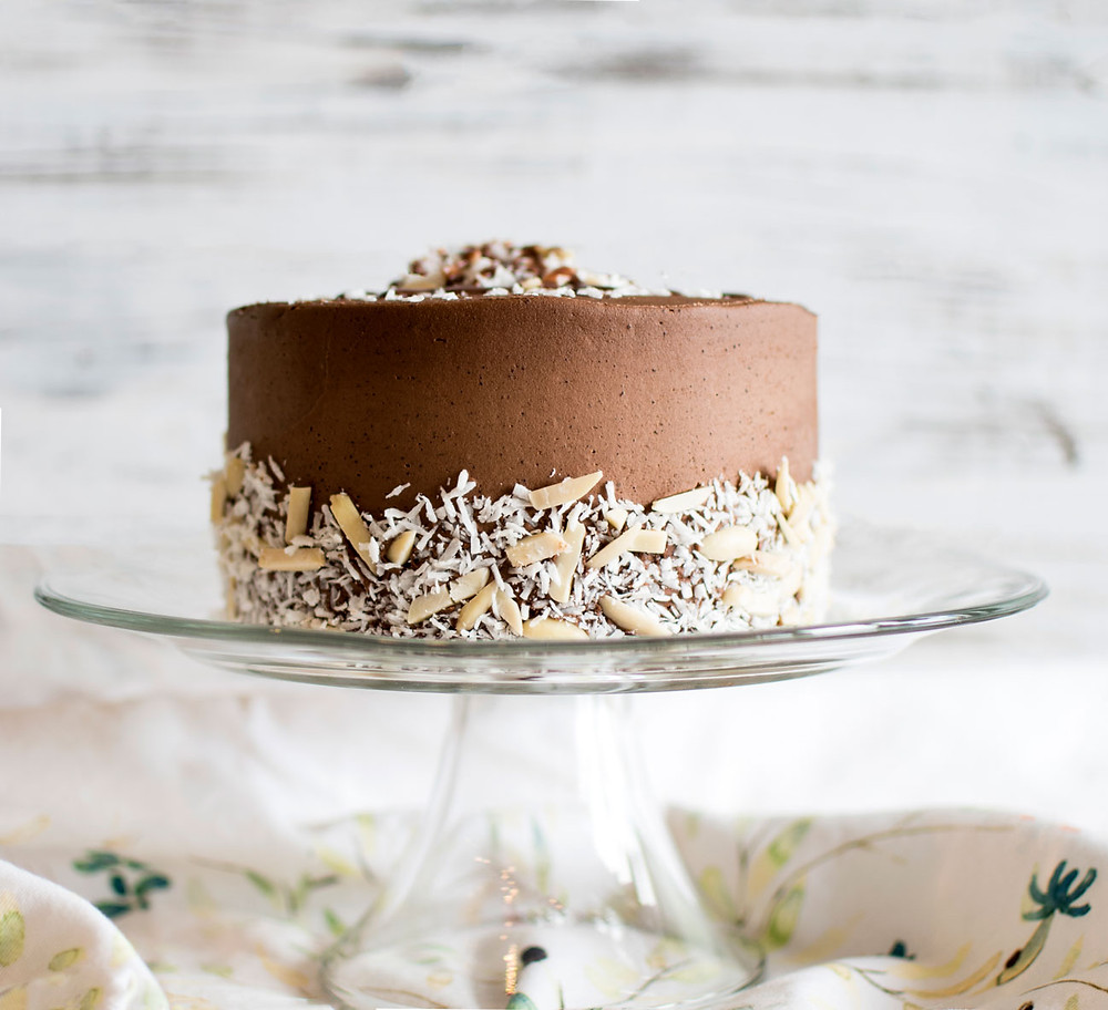Easy and delicious organic coconut joy cake recipe. Just like your favorite Almond Joy Candy bar, this cake recipe is reminiscent of this popular candy bar! Coconut, chocolate, and almonds make for the best Coconut Joy cake recipe.