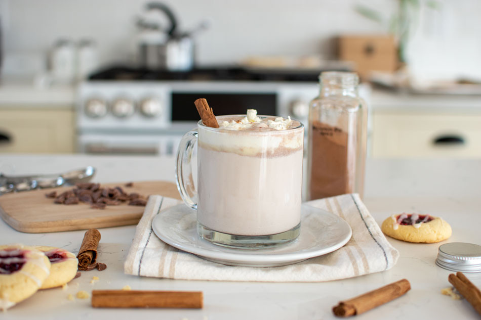 Boozy Pumpkin Spice Hot Chocolate recipe will keep you warm and cozy this fall. This easy cocktail recipe will spice up your hot chocolate game. A little bit of bourbon goes into a pumpkin spice hot chocolate for a seasonal drink you'll love #pumpkinspice #pumpkin #hotchocolate #hotcocoa #organic #boozy #cocktail