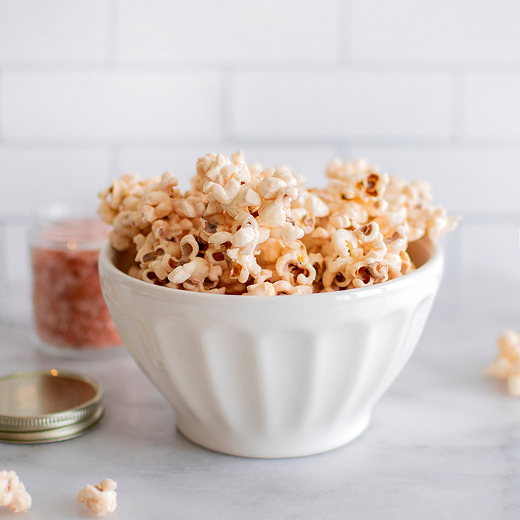 Side view of bowl full of Pink Himalayan Sea Salt White Chocolate Popcorn