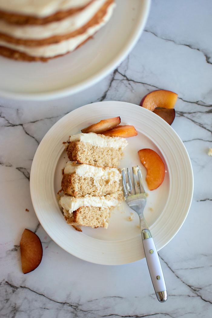 Easy naked layer cake, plum cake, cream cheese frosting, organic cake, easy cake recipe, beautiful cake recipe #organic #organiccake #nakedcake #glutenfreecake #glutenfree #creamcheesefrosting #cakerecipe