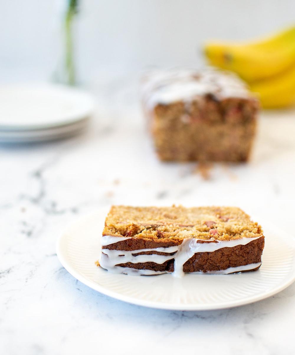 Strawberry Shortcake Banana Bread recipe using freeze dried strawberries! This easy and moist banana bread has an addition of freeze dried strawberries and glaze for a strawberry shortcake inspired banana bread. The best banana bread recipe for breakfast, snack, or dessert! #organicbaking #organicbananabread #bananabread #strawberryshortcake #strawberryshortcakebananabread #strawberriesandbanana #glutenfreebananabread