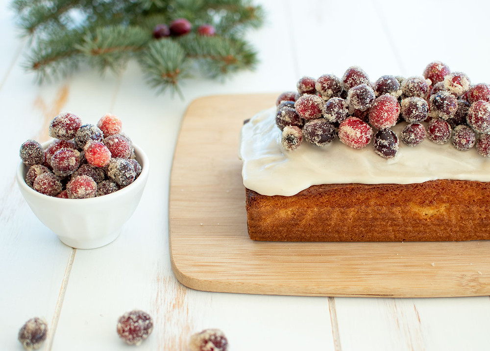 Easy and festive Champagne Loaf Cake recipe with Sugared Cranberries, a New Year's cake recipe. This easy loaf cake is made in my favorite USA Pan loaf pan, which makes baking and removing so easy! Sugared cranberries are a sweet topping to any cake that add festive sparkle for the holidays #sugaredcranberries #champagne #loafcake #usapan #organiccake