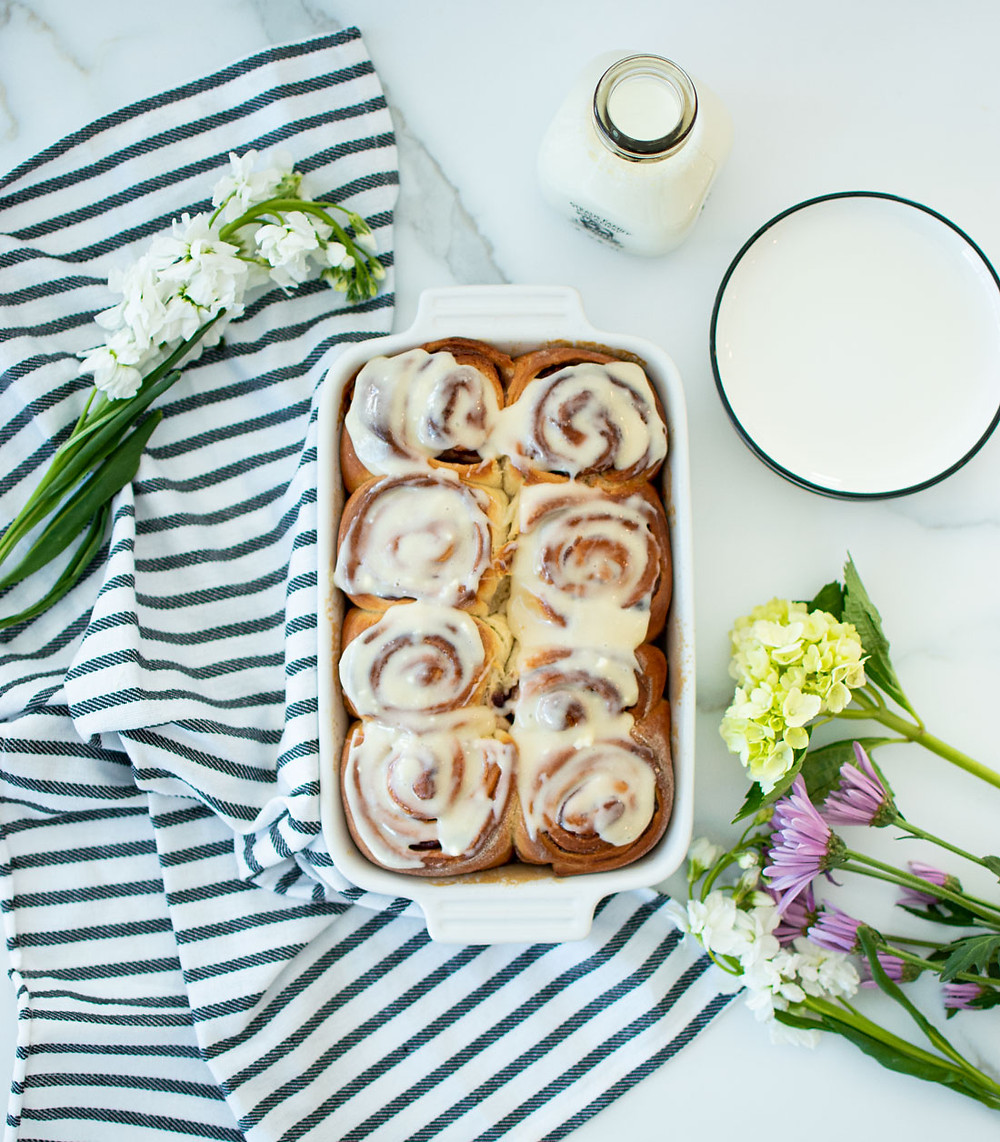 Easy Concord Grape Sweet Rolls with Cream Cheese Icing recipe, that's just perfect for brunch! These light sweet rolls are less sweet than cinnamon rolls but pack a punch with concord grape flavor and a perfect cream cheese icing. The recipe for these easy and different sweet rolls is one you're sure to love! #organic #organicbaking #organicbreakfast #organicbrunch #sweetrolls #highaltitudebaking #grapepastries #cinnamonrolls