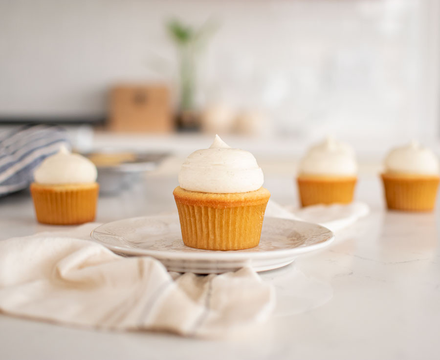 The best organic Vanilla Cupcake recipe. Made from scratch easy vanilla cupcakes. This moist vanilla cupcake recipe is sure to please everyone with its classic flavor profile. The only vanilla cupcake recipe you will need #organic #cupcakes #cupcake #vanilla #vanillacupcakes #vanillabean #highaltitudebaking #highaltitude #glutenfree #glutenfreecupcakes