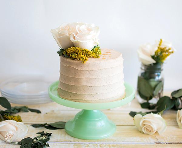 Cinnamon Maca Honey Cake on a cake stand