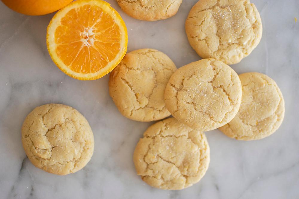 Orange Creamsicle Cookies with half orange beside it