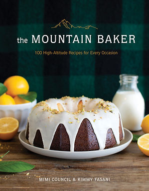 Cover of The Mountain Baker cookbook, with Lemon Pistachio Pound Cake on the front