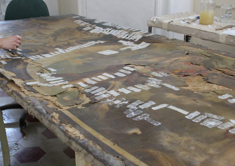 Stitching and first-aid conservation treatments.