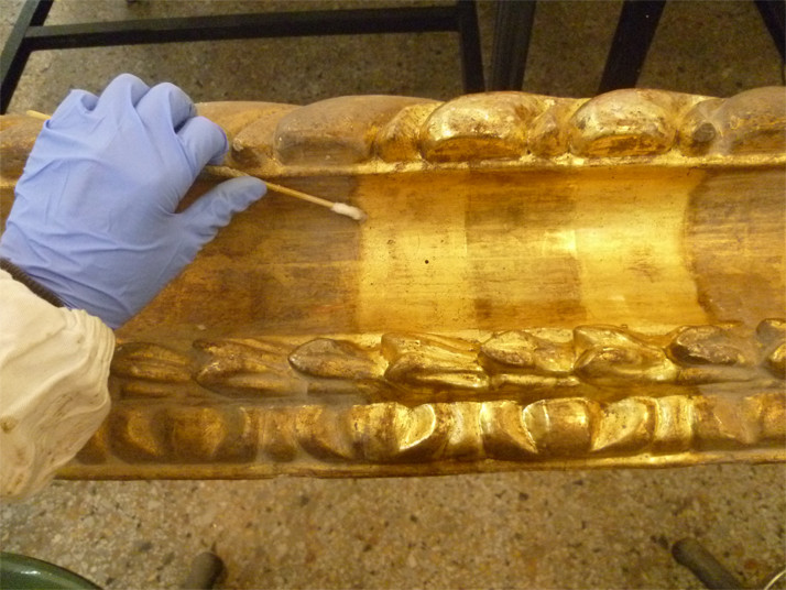 Cleaning treatments of the gilded decorative frame.