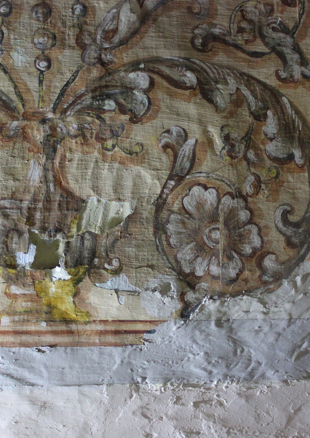 Detail taken before treatments using raking light and showing the poor condition in which the murals were found.
