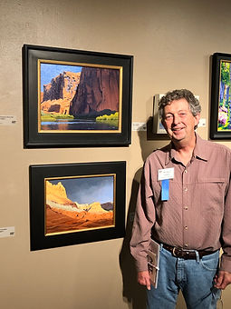 Mike with paintings 2.jpeg
