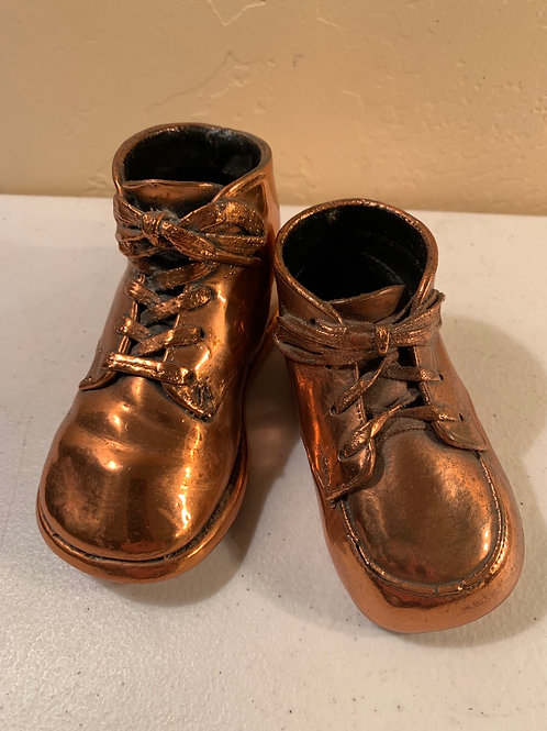 Two copper shoes, singles