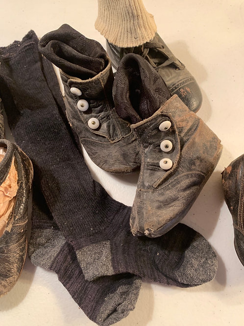 Antique shoes and socks, mixed group