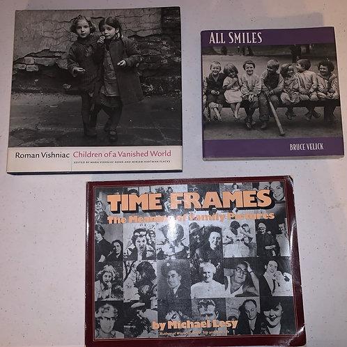 Three books, family photos and children