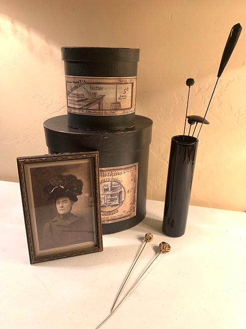 Six antique hat pins, two repro hat boxes, and one framed photo of a lovely lady