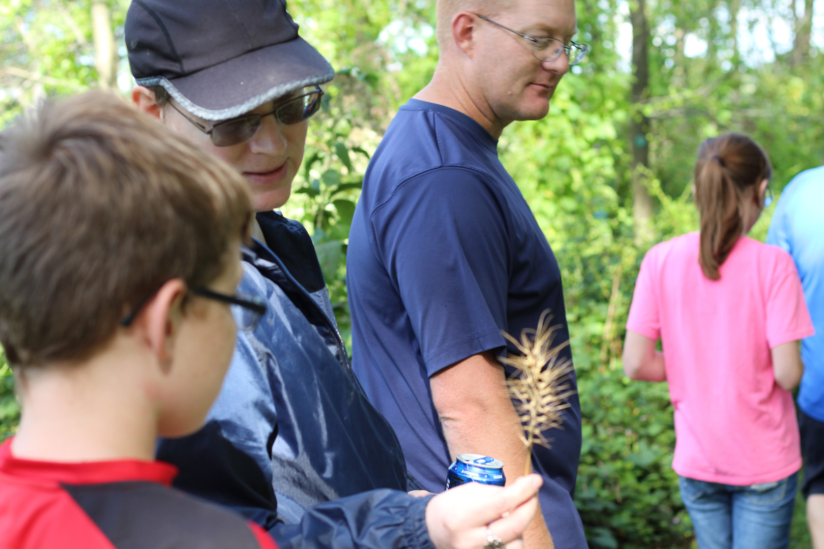 Visitors discuss the species of grass found at Androne Woods, during a Guided Hike.