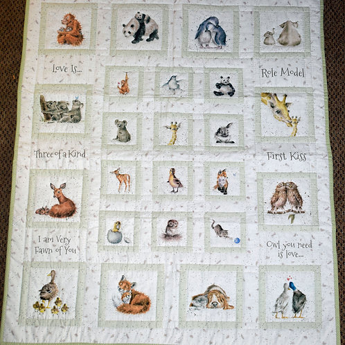 """Hand Quilted """"Love Is"""" Animal Lap Quilt"""
