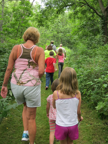 Hikers at Spring Creek Reseve, make their way through trees and brush near the creek in 2015. That property has changed significantly as restoration efforts take effect.