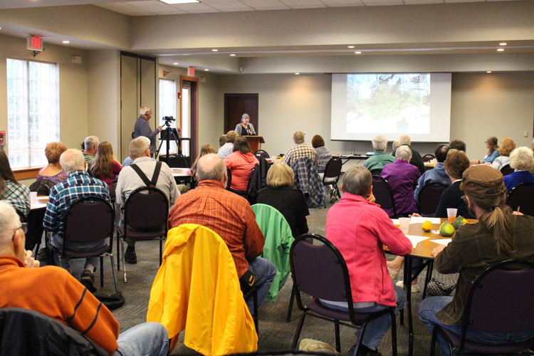 Attendees listen to Ivy Otto present an educational program on Yardscaping for Wildlife at G-RAS's Annual Meeting in 2017, held at Rotary Gardens.