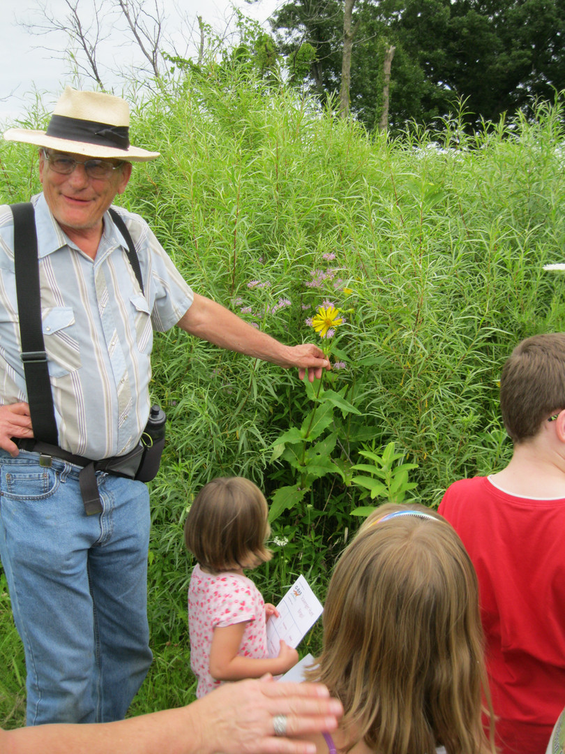 G-RAS Volunteer Coordinator & Land manager, Victor Illichmann, shows a variety on plant species at Spring Creek Reserve, during a public Guided Hike.