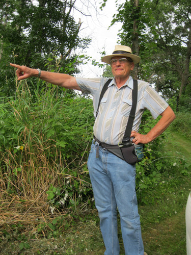 G-RAS Volunteer Coordinator & Land manager, Victor Illichmann, points out a cat bird.