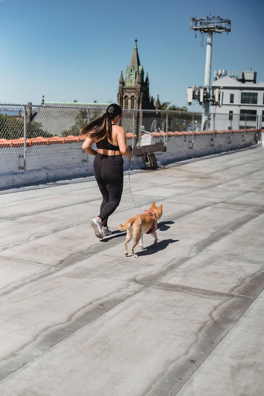 Female Runner Returning From Injury Running with dog