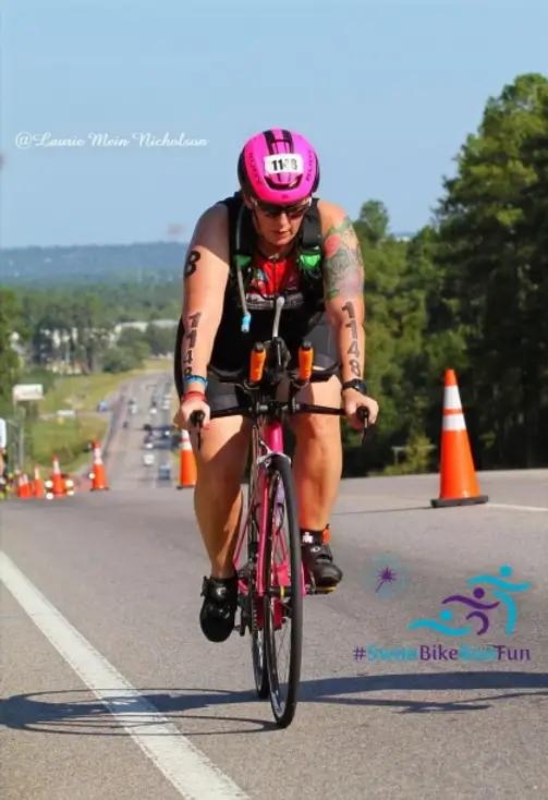 Cycling & Triathlon Mantra's Female Cyclist Racing on bike
