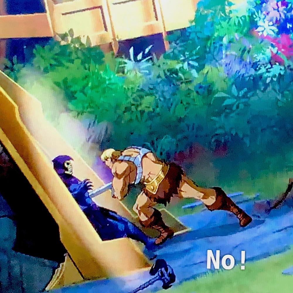 Skeletor being stabbed by He-Man