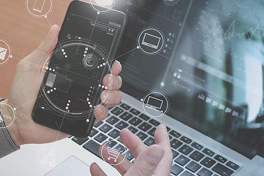 close up of hand using smart phone,lapto