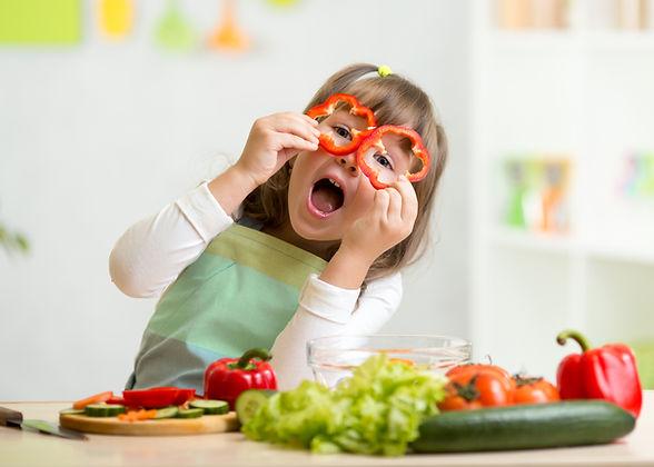 kid-girl-having-fun-with-food-vegetables