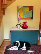 Monty and painting in a home's entry hal