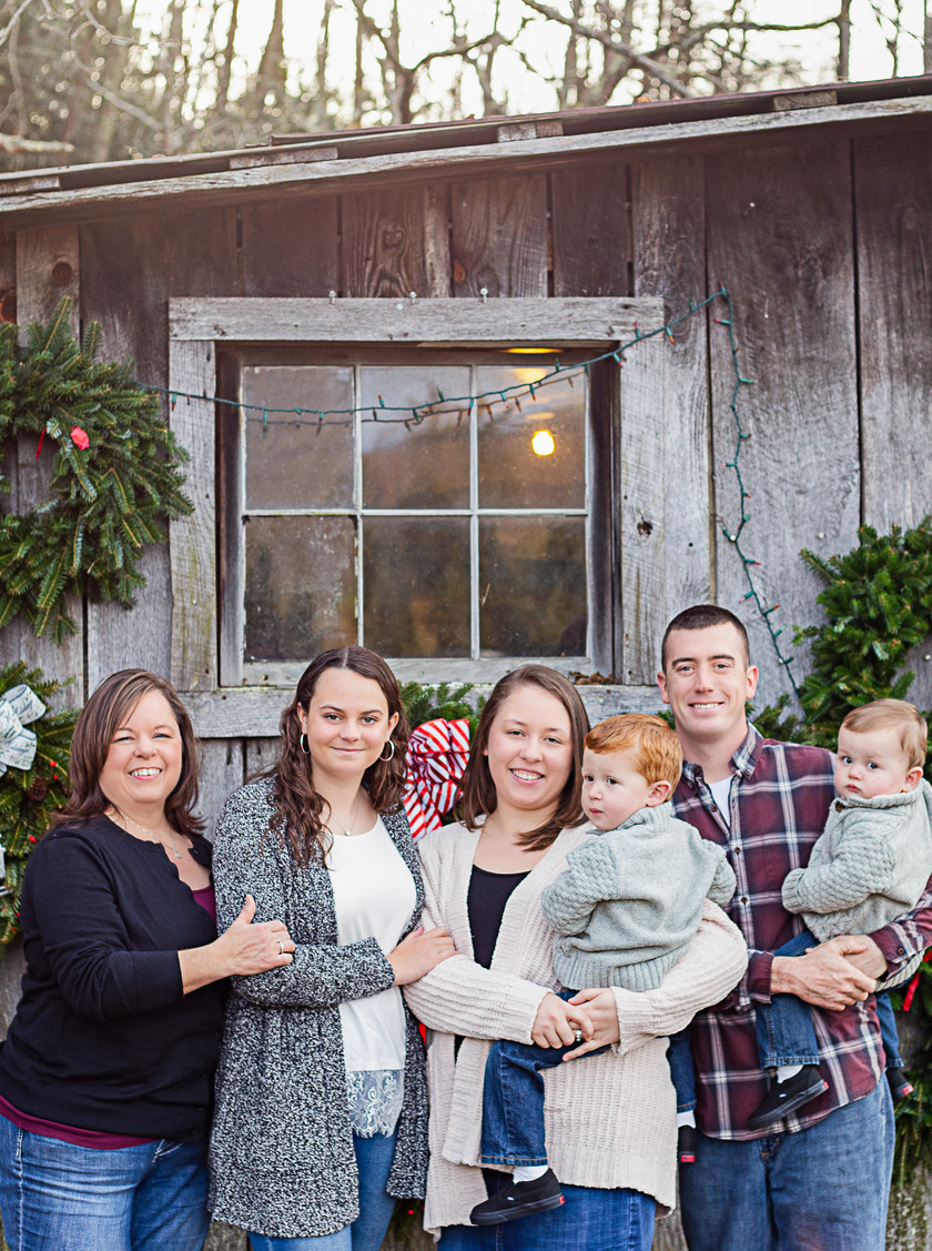 family Christmas photo at frosty mountain Christmas tree farm
