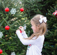 little girl hanging ornaments