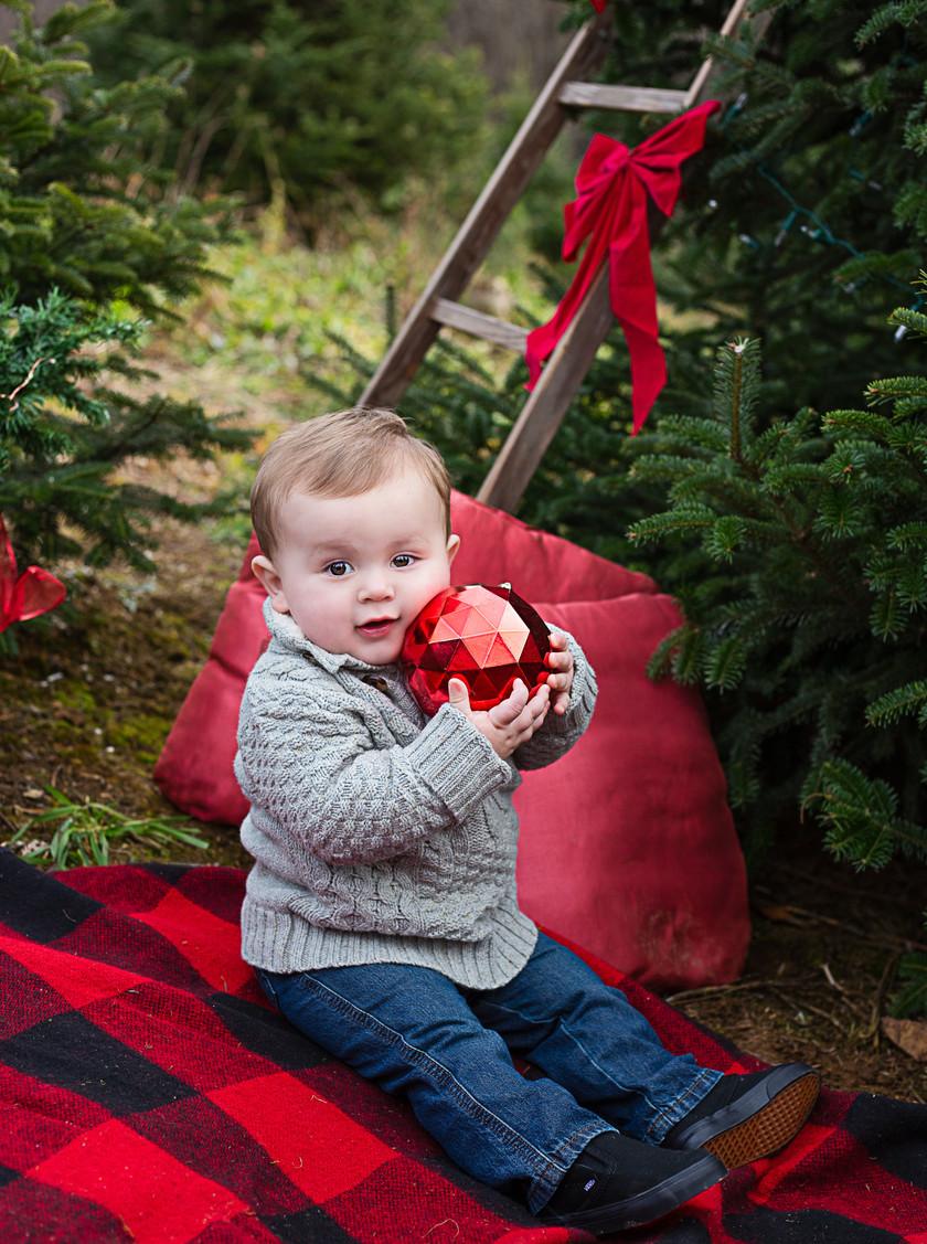 little boy hugging ornament