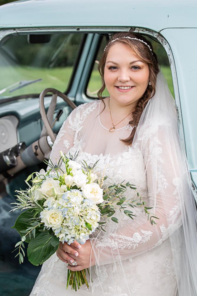 bride sitting in truck
