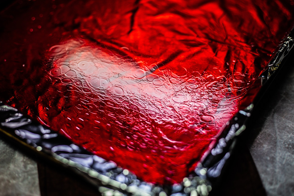 poured red glass candy