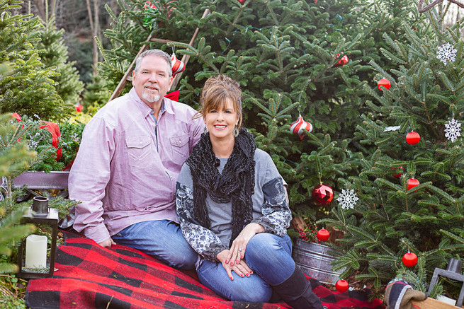 couple setting for Christmas photo session