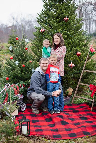 family at frosty mountain Christmas tree farm