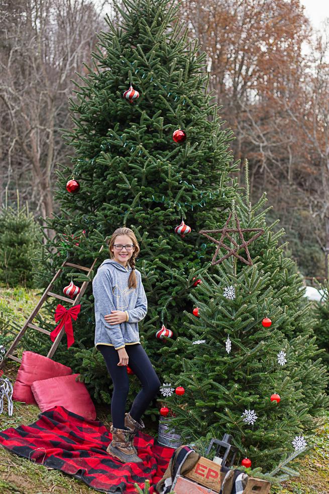 young girl posing at Christmas tree farm