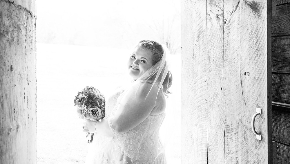 bride looking over her shoulder black and white