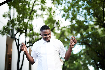 Standing in White Shirt Smile.jpg
