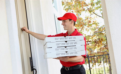 A%20handsome%20young%20pizza%20delivery%20man%20holding%20a%20pizza_edited.jpg