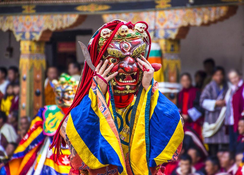 Masked Bhutanese festival dancer